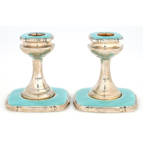 188 - <p>A PAIR OF GEORGE V SILVER AND TURQUOISE GUILLOCHE ENAMEL DWARF CANDLESTICKS, 8CM H, SHEFFIELD 193...