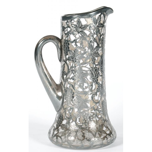 218 - <p>A NORTH AMERICAN SILVER OVERLAY GLASS JUG, DECORATED WITH GRAPEVINES, 27CM H, INDISTINCT MAKER'S ...