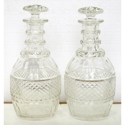 257 - <p>A PAIR OF 19TH C CUT GLASS DECANTERS AND STOPPERS, 23CM H</p>...