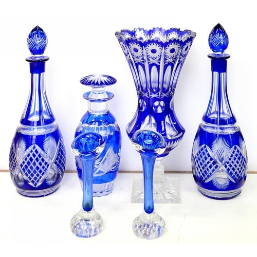 259 - <p>A SMALL COLLECTION OF DECORATIVE BLUE FLASHED GLASSWARE, COMPRISING A CUT GLASS WAISTED VASE ON C...