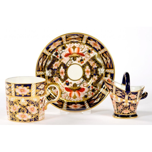 265 - <p>A ROYAL CROWN DERBY MINIATURE WITCHES PATTERN COAL SCUTTLE AND COFFEE CUP AND SAUCER, SCUTTLE 6CM...