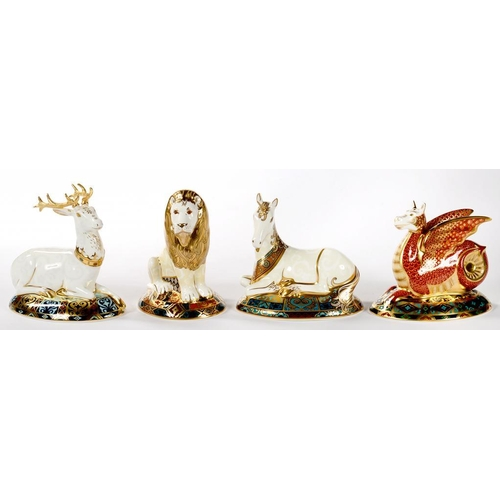277 - <p>FOUR ROYAL CROWN DERBY PAPERWEIGHTS, COMPRISING THE WHITE HEART, THE WESSEX WYVERN, HERALDIC LION...