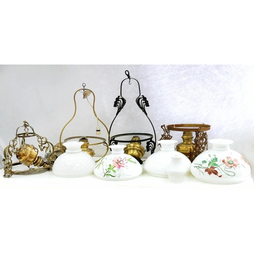 318 - <p>FOUR VARIOUS BRASS HANGING OIL LAMPS, EARLY 20TH C AND WHITE GLASS LAMPSHADES, VARIOUS SIZES</p>...