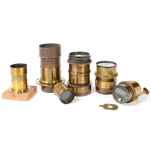 340 - <p>SIX 19TH AND EARLY 20TH C BRASS PHOTOGRAPHIC CAMERA LENSES, ENGRAVED E SUTER BASEL 15216 (PORTRAI...