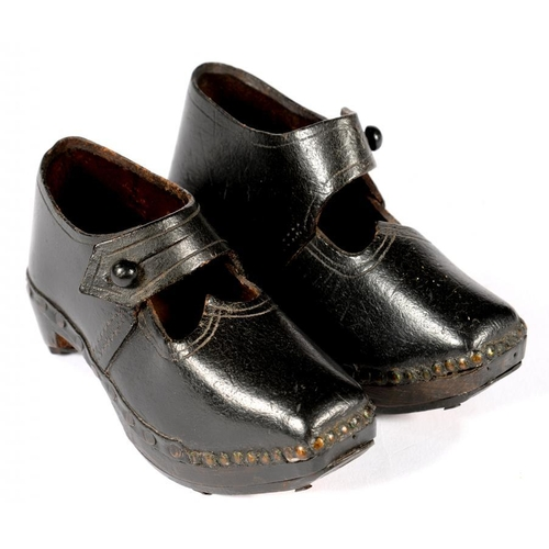 363 - <p>A PAIR OF EARLY 20TH C LANCASHIRE CARVED WOOD, BLACK LEATHER AND IRON SHOD CHILD'S CLOGS, 14.5CM ...