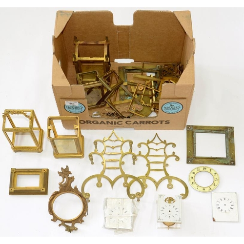 453 - <p>A QUANTITY OF MAINLY 19TH C BRASS OR GILT BRASS CLOCK CASE PARTS FOR CARRIAGE CLOCKS, BRACKET AND...