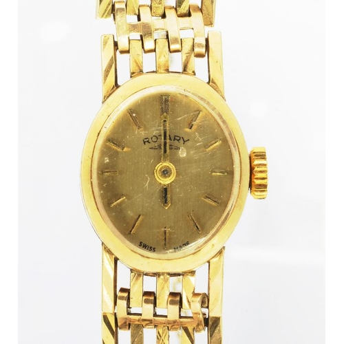 23 - <p>A ROTARY 9CT GOLD LADY'S WRISTWATCH, ON 9CT GOLD BRACELET, 17.6G </p>...