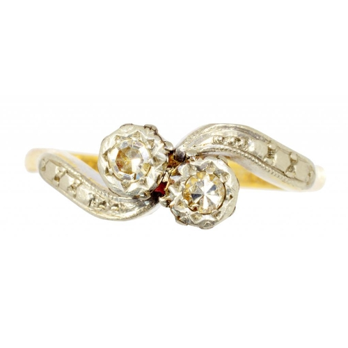 9 - <p>A DIAMOND CROSSOVER RING, ILLUSION SET IN GOLD, MARKED BRAVINGTONS 18CT AND PLAT, 3G, SIZE K</p>...
