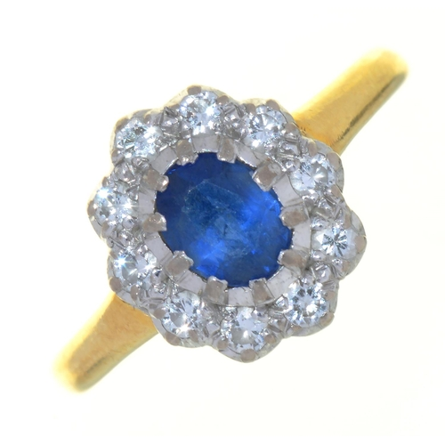 43 - A SAPPHIRE AND DIAMOND CLUSTER RING, IN 18CT GOLD, LONDON, 1987, 4G, SIZE P½...