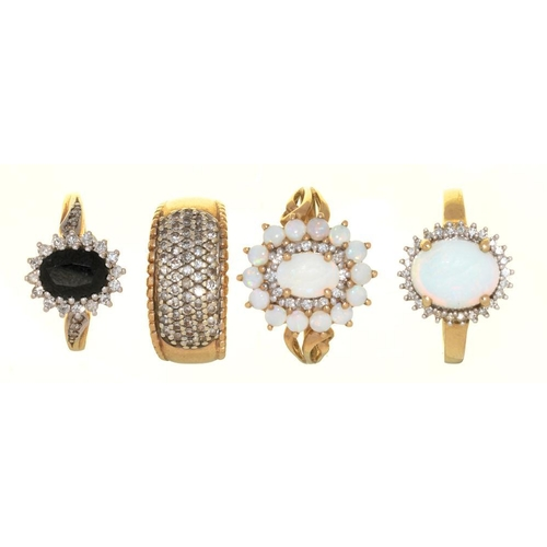 11 - <p>FOUR DIAMOND SET 9CT GOLD RINGS, COMPRISING A PAVE DIAMOND RING, STAMPED 0.50, TWO OPAL AND DIAMO...
