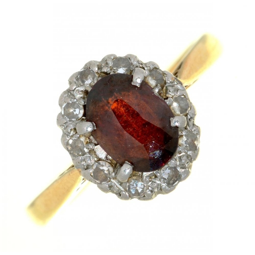 17 - <p>A GARNET AND DIAMOND CLUSTER RING IN GOLD MARKED 18CT, 3G, SIZE K</p><p></p>...