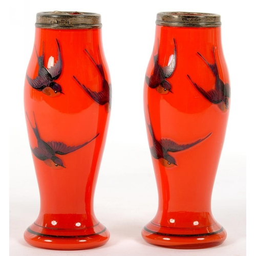 256 - <p>A PAIR OF SILVER MOUNTED RED GLASS VASES, ENAMELLED WITH BLUE BIRDS, 15.5CM H, LONDON 1925</p>...