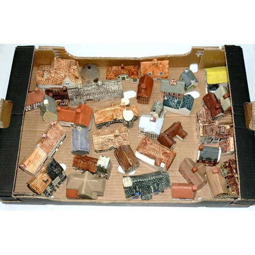 293 - <p>A COLLECTION OF 1970'S PAINTED AND GLAZED EARTHENWARE MODEL COTTAGES, 9CM H AND SMALLER, VARIOUS ...
