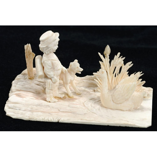 356 - <p>A MINIATURE CARVED IVORY GROUP OF A YOUNG SCHOLAR AND HIS DOG STANDING BEFORE A SWAN, 10.5CM L, L...