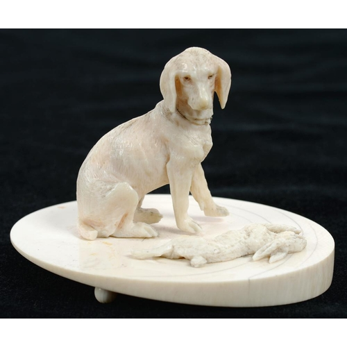 361 - <p>A MINIATURE IVORY CARVING OF A HOUND  AND RABBIT ON OVAL BASE, 9CM H, LATE 19TH C</p>...