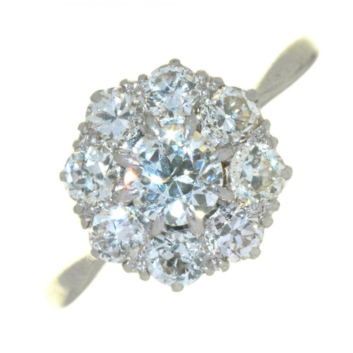 56 - <p>AN OLD CUT DIAMOND CLUSTER RING, OF FLORAL DESIGN, IN PLATINUM, MARKED PLATINUM, 3G, SIZE K</p><p...