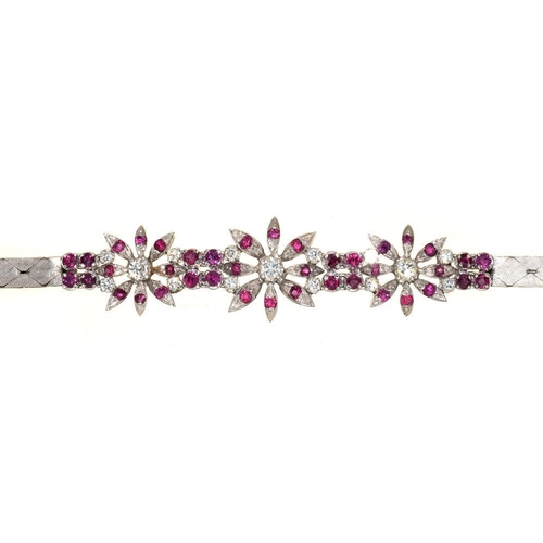 62 - <p>A RUBY AND DIAMOND BRACELET, OF FLORAL DESIGN, IN 18CT WHITE GOLD, 23G</p><p></p>...