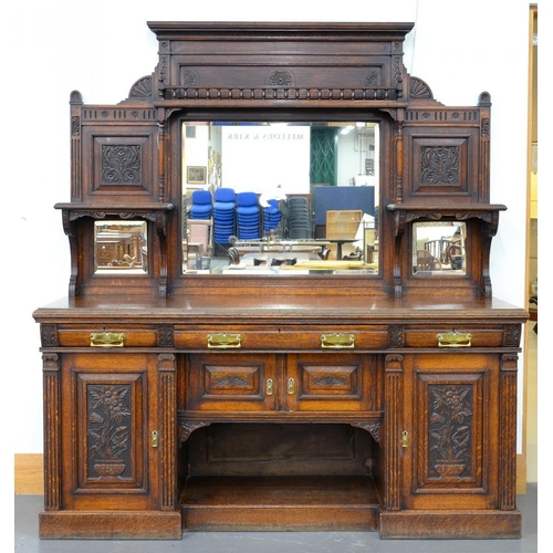 649 - <p>A VICTORIAN CARVED AND PANELLED OAK MIRROR BACK SIDEBOARD, 217CM H; 196 X 60CM </p>...