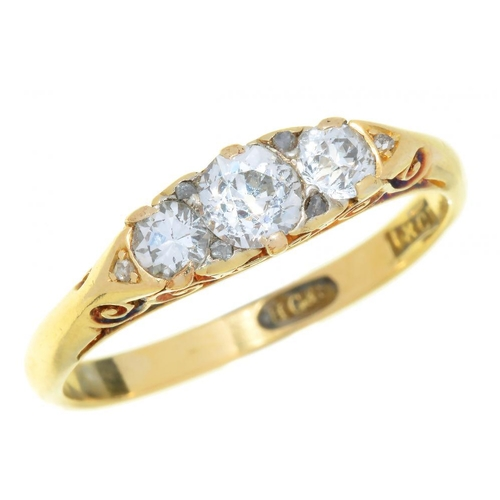 14C - <p>A VICTORIAN THREE STONE DIAMOND RING in gold, marked 18ct, 3g, size P</p><p></p>...