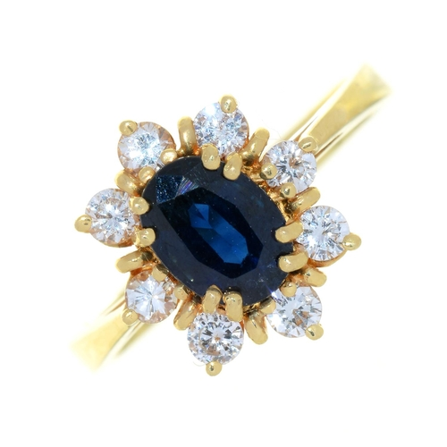 6 - A SAPPHIRE AND DIAMOND CLUSTER RING IN GOLD MARKED 750, 3.5G, SIZE K½...