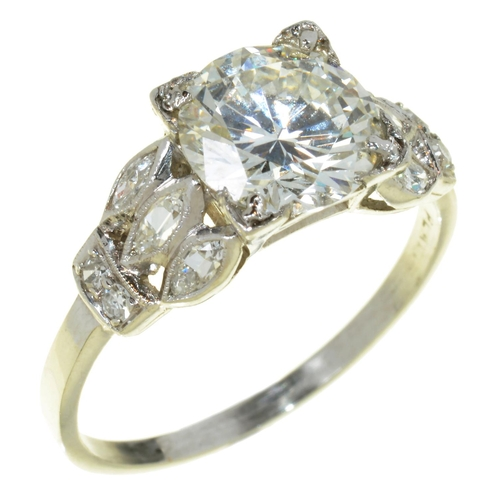 13 - <strong>A DIAMOND SOLITAIRE RING </strong>with pierced shoulders, the brilliant cut diamond 1.9ct ap...