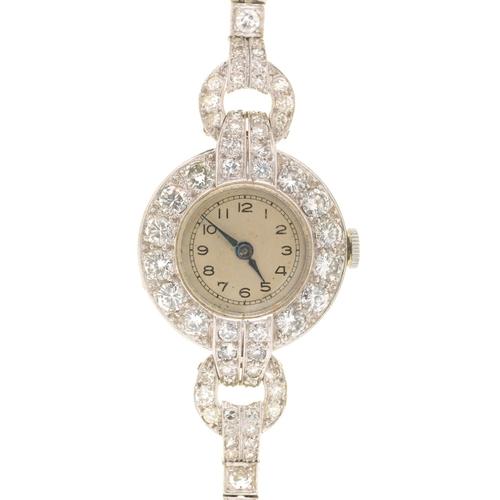 39b - A DIAMOND COCKTAIL WATCHON DIAMOND BRACELET, C1940in platinum, 3.9 x 2.3cm including lugs...