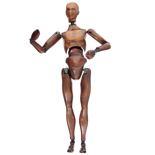 628 - <strong>A FRENCH CARVED AND STAINED BEECH AND BRASS BALL JOINTED ARTIST'S LAY FIGURE, LATE 19TH C</...