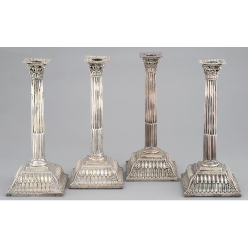 111 - A SET OF FOUR GEORGE III SILVER CANDLESTICKS the slightly tapered, stop fluted column beneath pie...