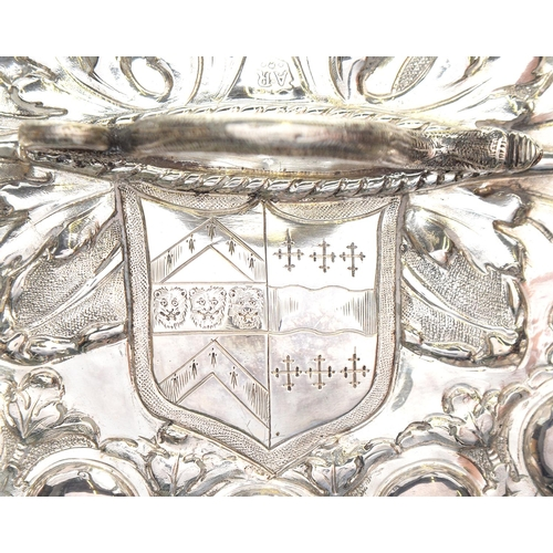 112 - <strong>A CHARLES II  SILVER SUGAR BOX  </strong> of crisply chased oval shape with lobed sides, the...