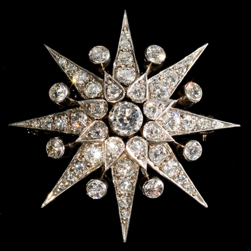 12 - <strong>A DIAMOND STAR BROOCH, 20TH C </strong> in the form of an eight pointed star, mounted in gol...