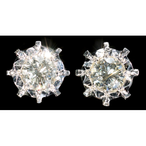 15 - <strong>A PAIR OF DIAMOND EAR STUDS  </strong>with round brilliant cut diamonds mounted in white gol...