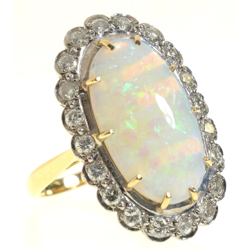2 - <strong>AN OPAL AND DIAMOND RING </strong> the 10 x 19mm oval opal of fine polish, in gold marked 18...