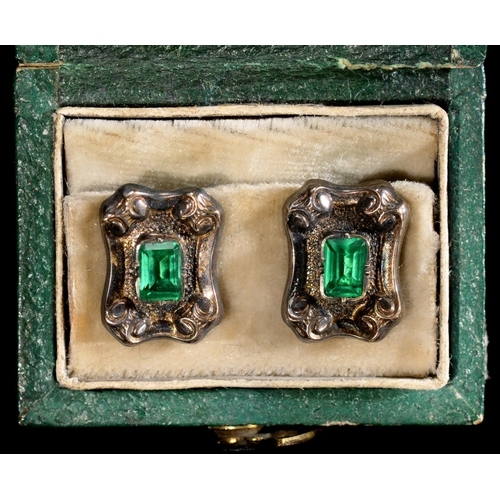 25 - <strong>A PAIR OF FRENCH FOILED GREEN PASTE, SILVER AND GOLD DRESS STUDS, 19TH C</strong>10 x 13mm...