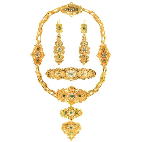 27 - <strong>AN EMERALD, PEARL AND GOLD DEMI PARURE, C1840 </strong>pierced and crisply chased with scrol...