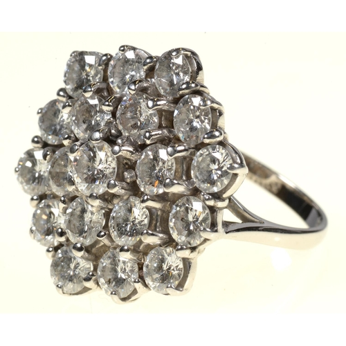 3 - <strong>A DIAMOND CLUSTER RING </strong> of nineteen evenly sized round brilliant cut diamonds arran...