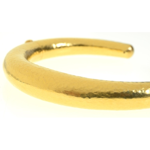34 - <strong>ILIAS LALAOUNIS. A GREEK GOLD BANGLE </strong>with two invisible hinges, 74mm, maker's and c...
