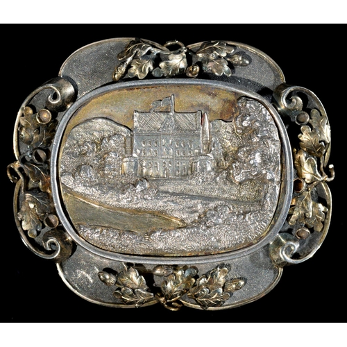 38 - <strong>ROYAL. A PARCEL GILT SILVER BROOCH</strong>with cast oblong engraved bas relief view of a ...