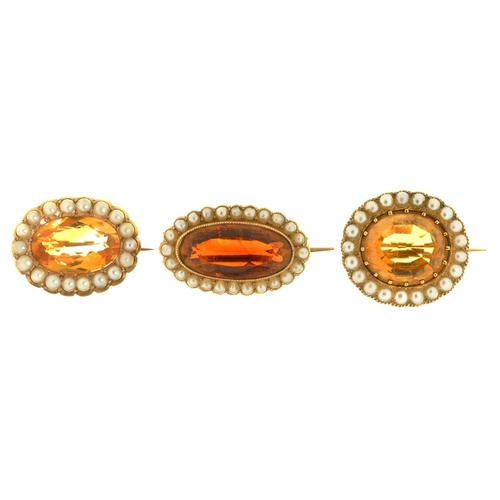 44 - <strong>THREE VICTORIAN CITRINE AND PEARL BROOCHES, MID 19TH C</strong> in gold, 256mm and smaller,...