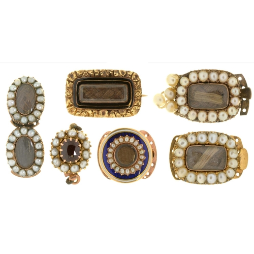 45 - <strong>A GROUP OF GOLD MOURNING BROOCHES AND SLIDES </strong> all but one set with split pearls, tw...