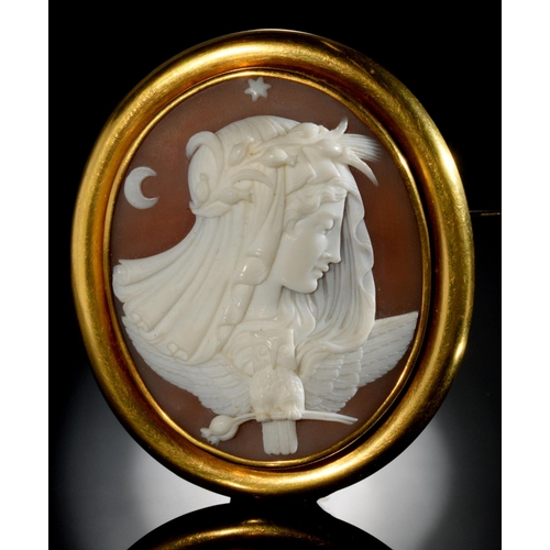 48 - <strong>A FINE VICTORIAN CAMEO BROOCH</strong> the oval shell carved with the personification of nig...