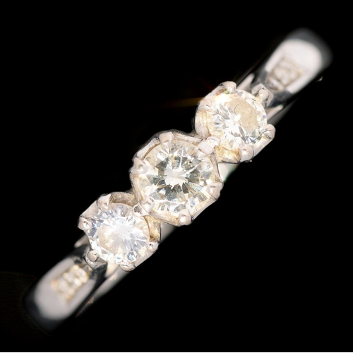 5 - <strong>A DIAMOND THREE STONE RING </strong>with round brilliant cut diamonds and diamond set should...