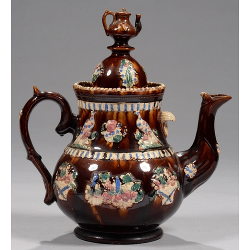 849 - <strong>FOOTBALL INTEREST. A BARGEWARE TEAPOT AND COVER, DATED 1902</strong>sprigged with birds, ...