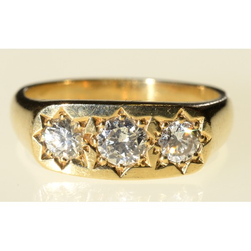 40 - <strong>A DIAMOND RING </strong>gipsy set with three modified round brilliant cut diamonds, in 18ct ...