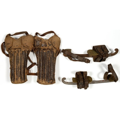 848 - <strong>SPORTING INTEREST. A PAIR OF VICTORIAN STEEL, BRASS AND LEATHER ICE SKATES, LATE 19TH C</...