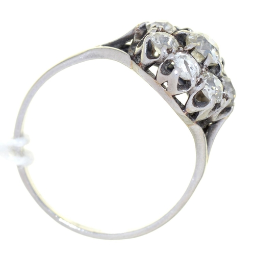 28 - A DIAMOND CLUSTER RING, WITH NINE OLD CUT DIAMONDS, PLATINUM COLOURED METAL HOOP, MARKED WITH AN INV...