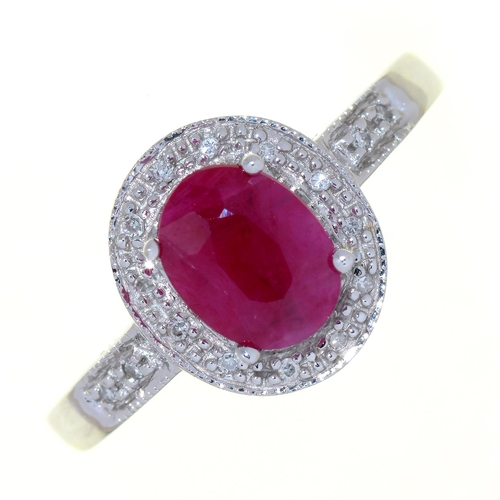34 - A RUBY AND DIAMOND CLUSTER RING, IN WHITE GOLD WITH PIERCED SHOULDERS, MARKED 14K, 4.1G, SIZE M...