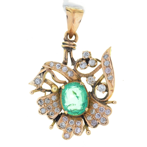 51 - AN EMERALD AND DIAMOND PENDANT OF LEAFY FLORAL DESIGN, CENTRED BY A LARGER STEP CUT EMERALD IN GOLD,...