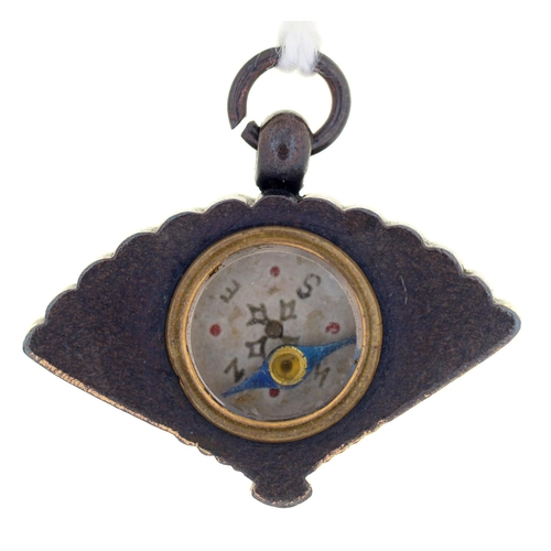60 - A JAPANESE SHIBUICHI AND GOLD FAN SHAPED FOB PENDANT, THE BACK INSET WITH A COMPASS, MEIJI PERIOD, 2...