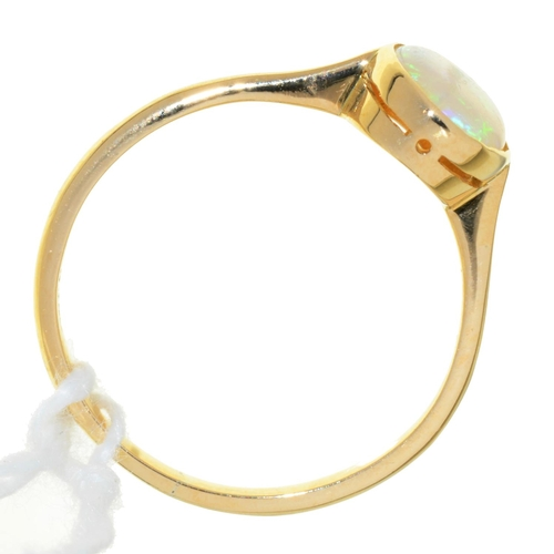 25 - AN OPAL RING, IN GOLD, MARKED 18CT, 2.1G, SIZE N...