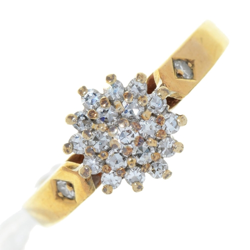 3 - A DIAMOND HEXAGONAL CLUSTER RING, IN 9CT GOLD, LONDON 1985, 2.4G, SIZE L½...